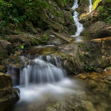 Little waterfall at the base of Temurun falls on the island of Langkawi, Malaysia. While not the main attraction, it's still makes a nice image