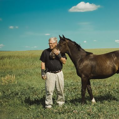 Farmer hugs his horse