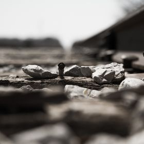 A shallow depth of field view of a railroad tie.