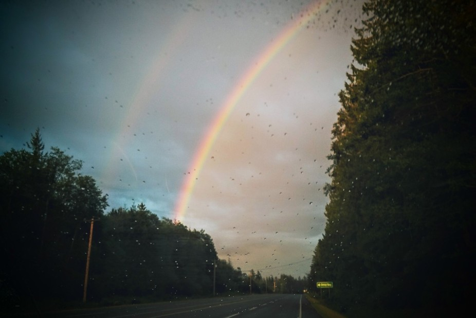 Driving home in the rain and two rainbows were in front of me