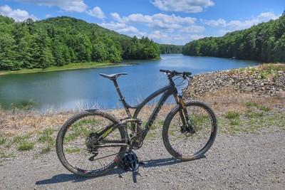 Mountain biking by the lake.