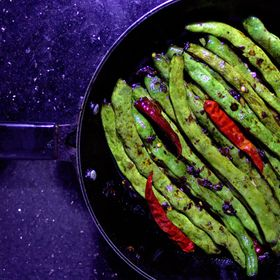 Green Beans Stir Fry with soy sauce on pan.