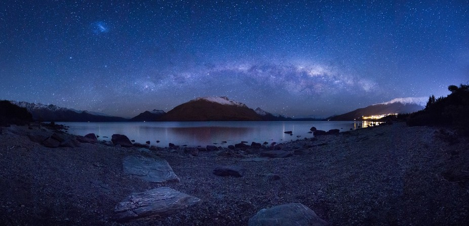This is a two layer multiple image panorama of the milky way low in the sky over the mountains ne...