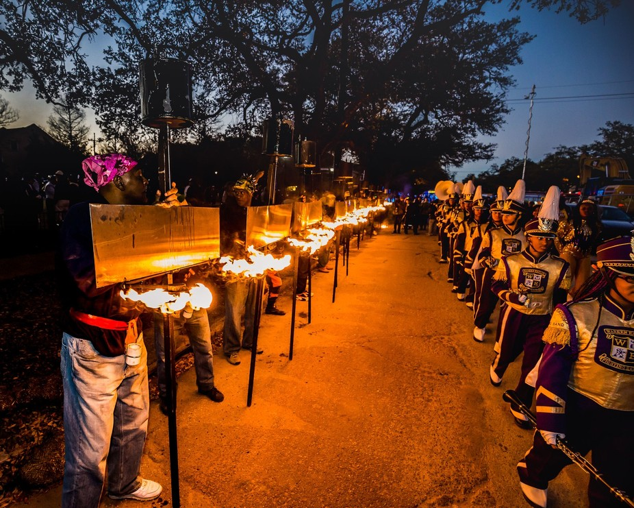 New Orleans, LA Mardi Gras 2016; The Flambeauxs have their torches ready to light the parade as i...