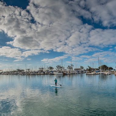 An early morning stand-up paddler at the Dana Point Marina in California
