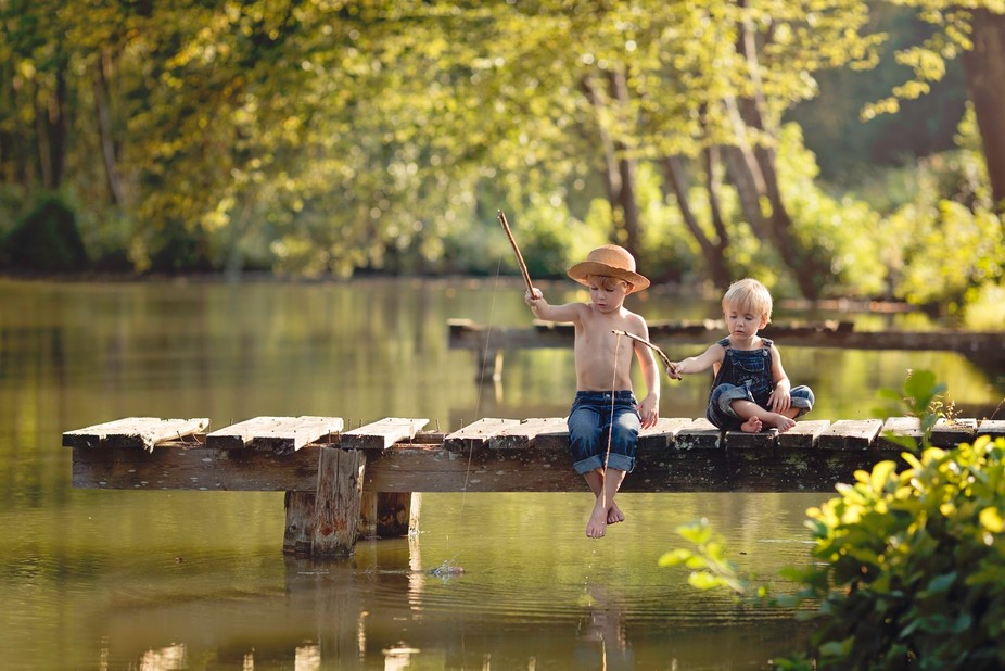 My little ones playing with some homemade fishing poles.