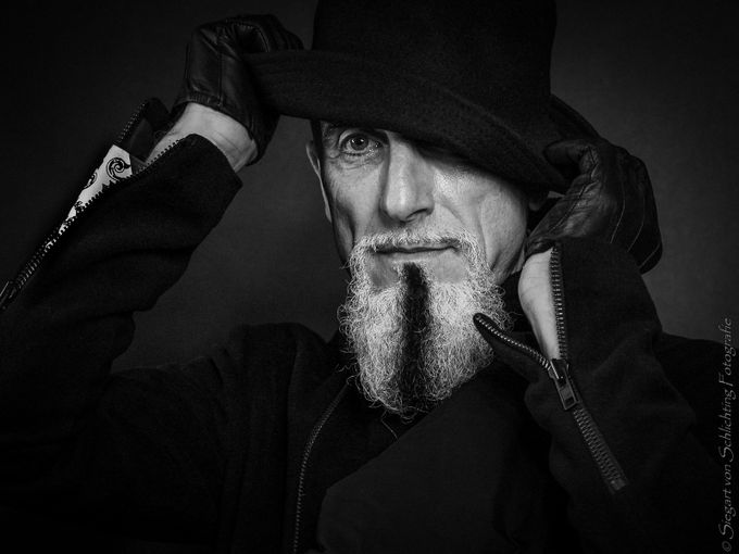 Man in black by siegart - The Face Of A Man Photo Contest
