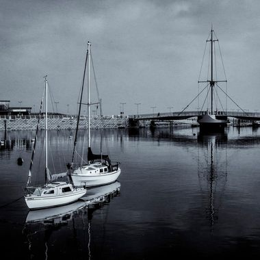 Yachts in Rhyl Harbour with Pont y Ddraig in the background.