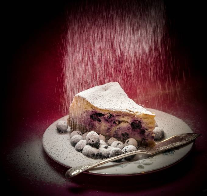 blueberry cheesecake getting a sprinkling of icing sugar by zoemeadows - Looks Delicious Photo Contest