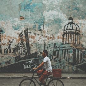 On a walk to buy rum, I noticed a large painted mural on one of the crumbling walls of Havana. It was the key buildings and charms of the city al...