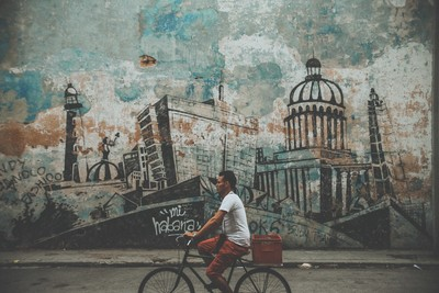 Man on Bicycle infront of Havana Mural