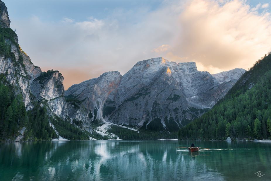 Photo of a little boot during the Sunset over a see in the dolomite