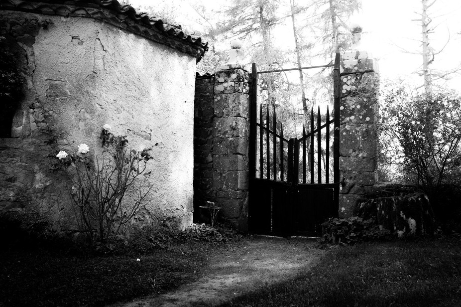 The gate that leads to the gardens of Chateau Folgoux in France