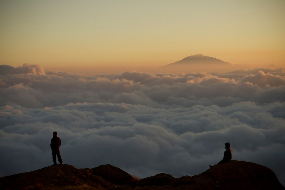 Climbing Mt. Kilimanjaro, the tallest freestanding mountain in the world, you live above the clou...