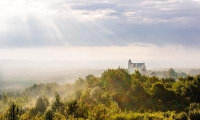 Bobolice Castle in the morning haze