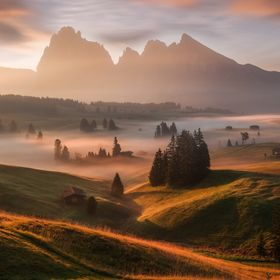 The Seiser Alm is Europe's largest high alpine plateau, located in Italy's Dolomites mountain range which rise's up from the surro...