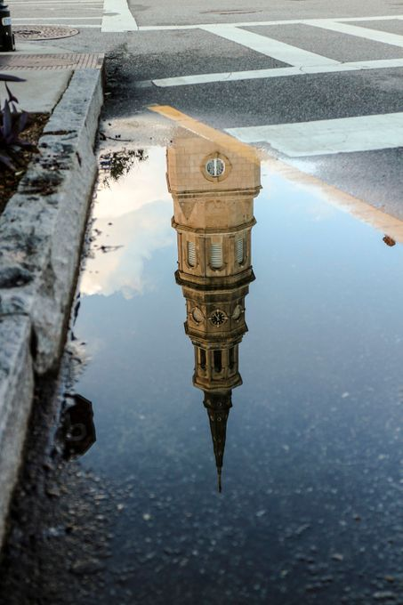 Puddle reflection in the street in Charleston, SC