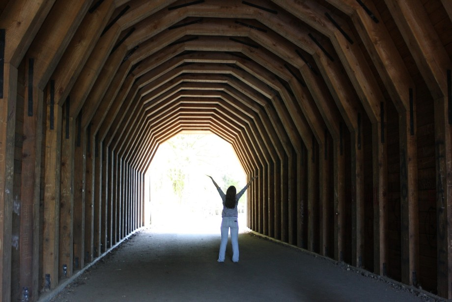 My daughter walking towards the light at the end of the tunnel in Oregon