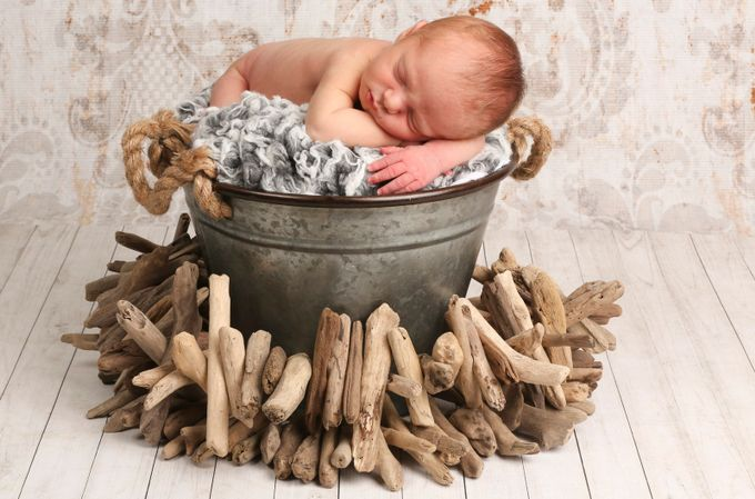 Newborn with Driftwood by acooper11 - Kids With Props Photo Contest