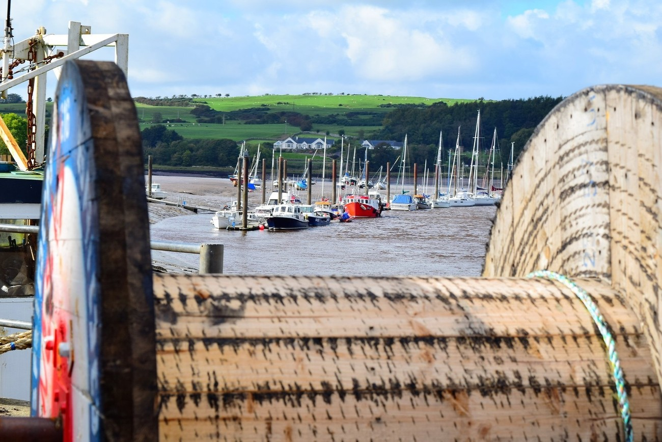 Taken through a cable reel on the harbour at Kirkcudbright.