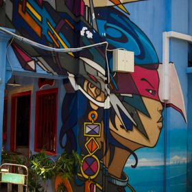 Somewhere in Singapore, in a laneway on the side of a cafe resides some really colorful street art.