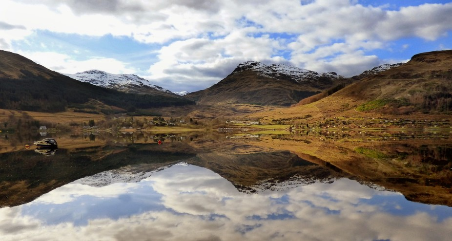 Loch Goil in Argyll and Bute Scotland.  Beautiful reflections of the snow covered mountains in th...