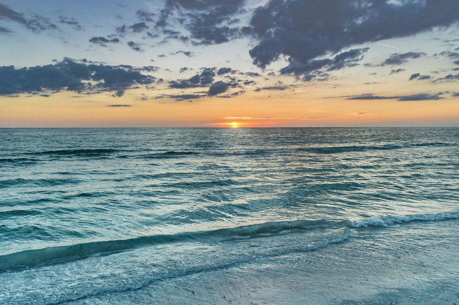 Just another beautiful Summer sunset on Pass A Grille beach as the sun sinks low into the Gulf of...
