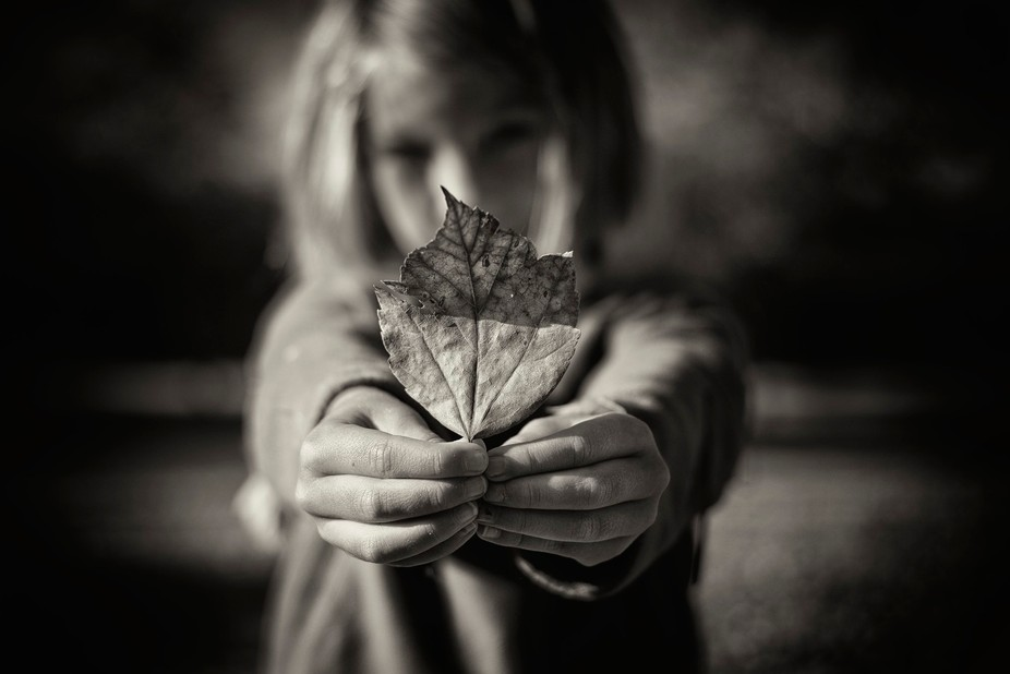 My daughter showing me a leaf she found in the park.