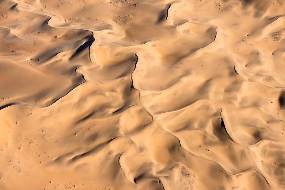The beauty of nature, the beauty of the desert seen from the helicopter at sundown. Namib desert,...