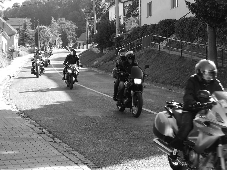 A long row of bikers make it through a village in south moravia, Czech republic