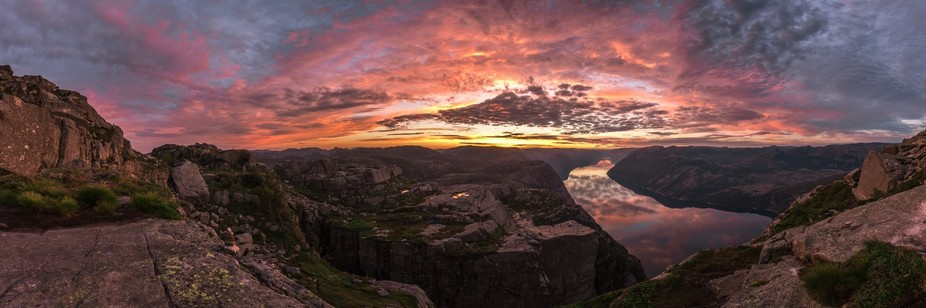 Pastel colors light up the sky as the sun rises over Preikestolen, the Pulpit Rock of southern No...
