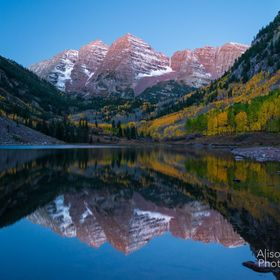 Reflected light creates a great reflection. Light reflected from the moon lights up the Maroon Bells just a bit before dawn.