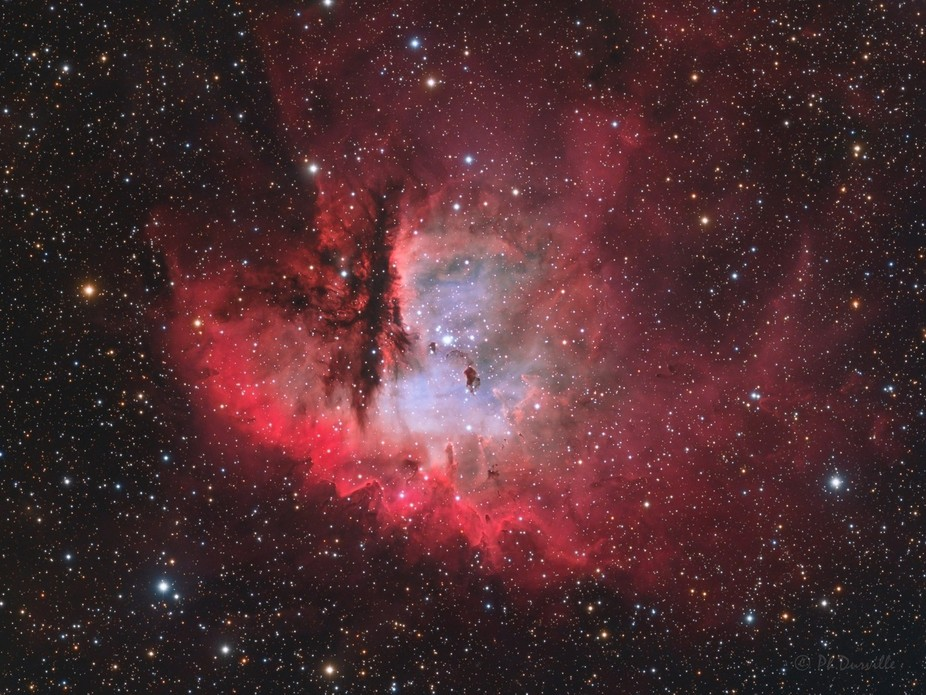 NGC 281 is an H II region in the constellation of Cassiopeia and part of the Perseus Spiral Arm. ...