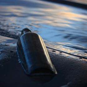 Taken during Scott Kelby Worldwide Photowalk, 10-1-2016 Old bottle at the edge of the water with clouds reflected in the water. Thought it turned...
