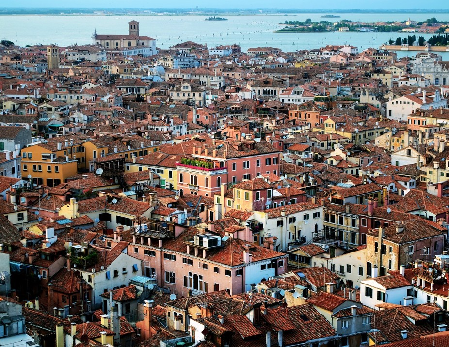 View over the rooftops of Venice from the bell tower of St. Mark. Evening sunlight