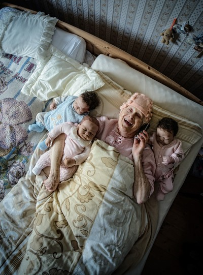 With grandma in bed