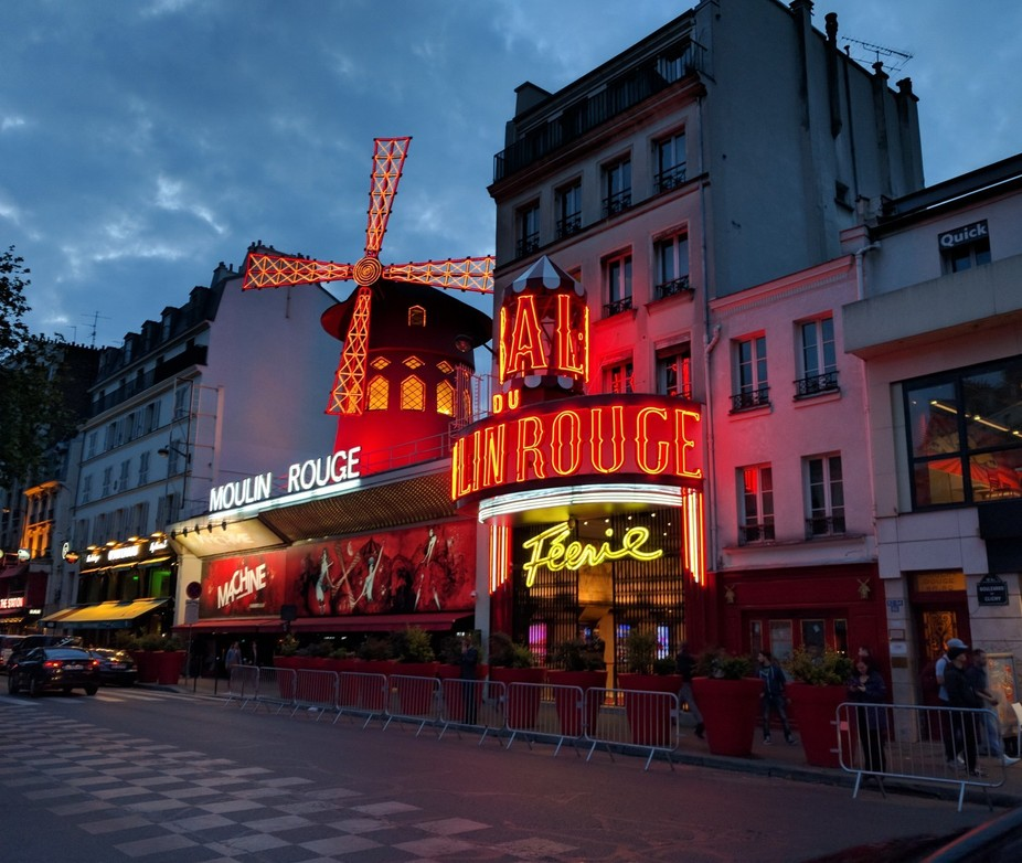 The famous Moulin Rouge waking up as day turns to night. The show was awesome, but of course you&...