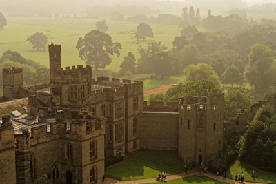 Warwick castle in the morning mist