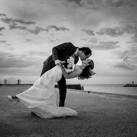 On this windy day at the beach in The Hague Netherlands, the groom went for a kiss and the vail took off!