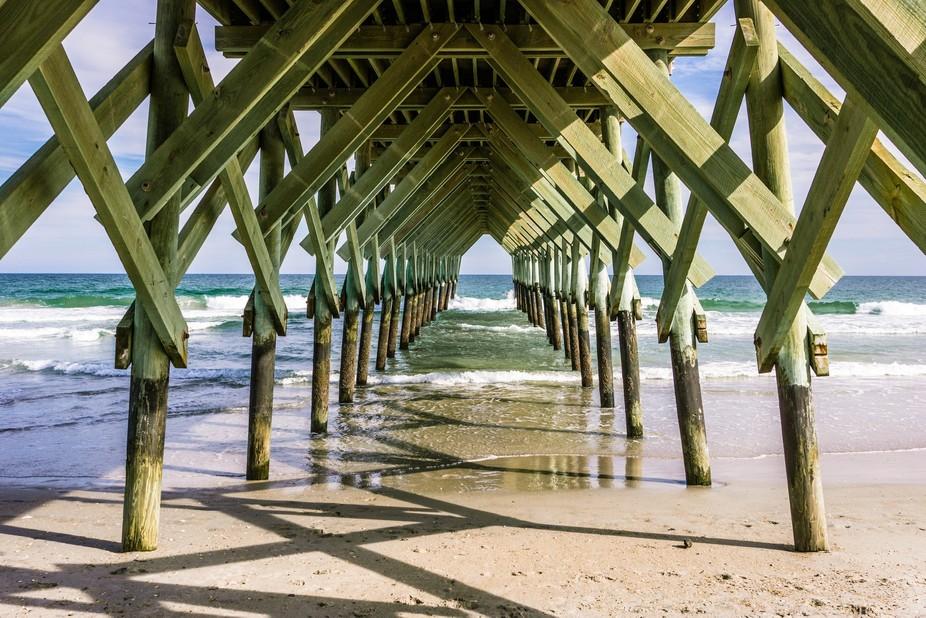 Beneath Crystal Pier at Wrightsville Beach, North Carolina, USA.