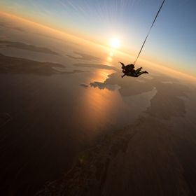 Sunset skydive over the islands.