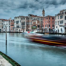 Boats rip along the Grand Canal in Venice.