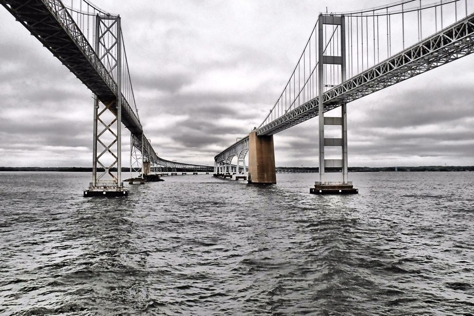 The twin spans of the Chesapeake Bay Bridge in Maryland as shot from the water.