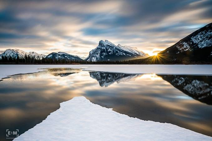 Vermilion Sunburst by erikmcritchie - The Moving Clouds Photo Contest