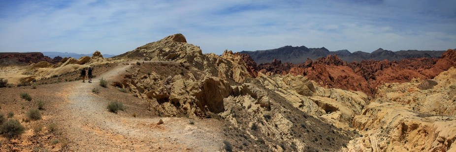Rainbow colored rocks at Valley of Fire, Nevada State Park. Looking through 150 million years of ...
