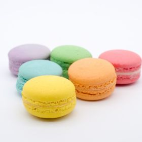 a bunch of colorful macaron in different flavours
