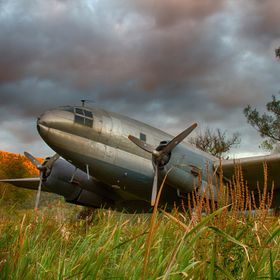 Vintage aircraft out in a field. Fall approaches......