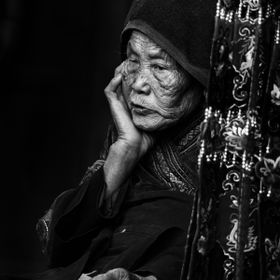 In silence, she watched as the commotion died down and the village regained its tranquility. Langde Miao Village, a favorite tourist destination ...