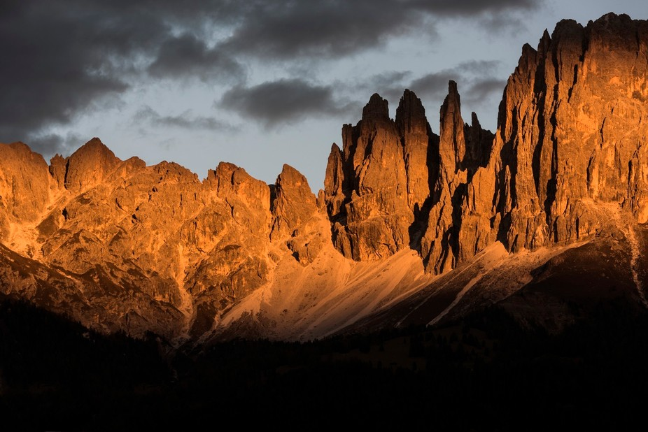 Sunset as seen from the village of Tires. Taken at 160mm on the 80-400.   The Vajolet towers are an iconic symbol of the Dolomites, particularly amongst climbers and alpinists. Torre Delago (the right-hand tower pictured here) is particularly famous for its incredibly exposed Piaz Arete.