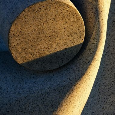 A close-up of a stone sculpture in the morning light.